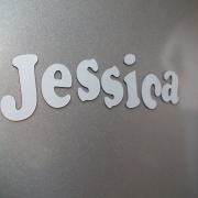 Laser cut letters with magnetic backing
